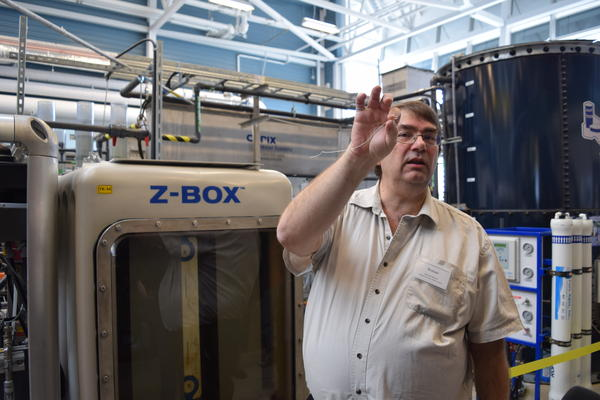 Walkerton Clean Water Centre CEO Roman Martiuk explains one of the many water treatent processes at the Centre