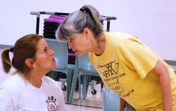 "Patty Prewitt (right) and Amy Sherrill perform a scene from ""Run-On Sentence"" in the Prison Performing Arts production at the Women's Eastern Reception, Diagnostic and Correctional Center"