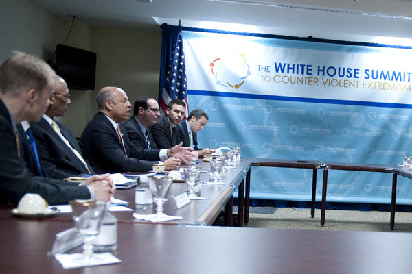 Jeh Johnson (third from left) - then Secretary of Homeland Security - speaks at the White House Summit to Counter Violent Extremism in 2015.