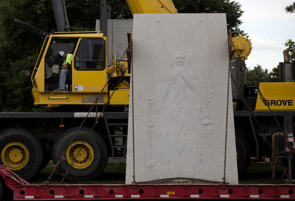 A piece of the Confederate Memorial sits on a truck bed before being hauled away.