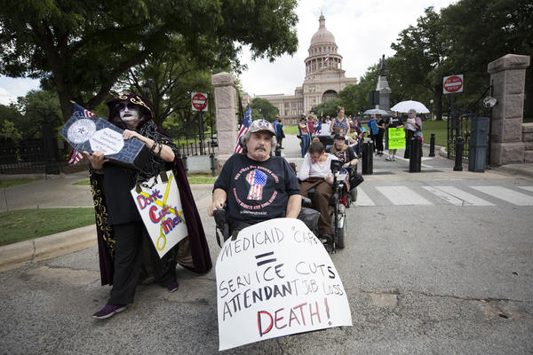 Demonstrators march in protest of the Senate health care bill, in Austin on Wednesday.