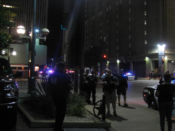 Dallas police officers flooded downtown following the deadly shooting Thursday night.