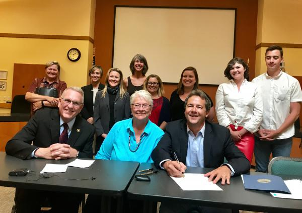 In Missoula Monday, Montana Attorney General Tim Fox, left, joined Sen. Diane Sands, Gov. Steve Bullock and people who helped lawmakers update state sexual assault laws