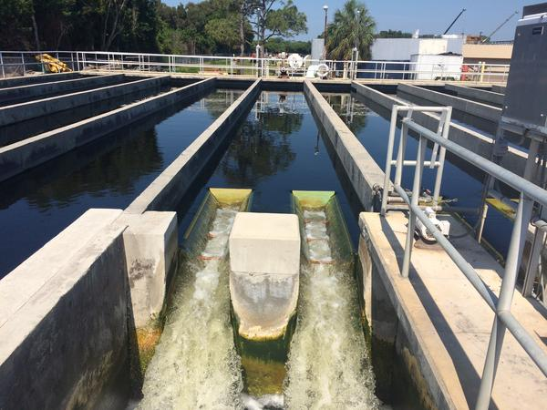 Water flows from a chlorine contact chamber at a water treatment facility in south St. Petersburg.