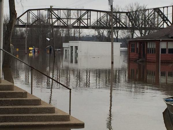 A nearby playground and building were flooded in Thebes, Illinois on Wednesday on Dec. 30, 2015.