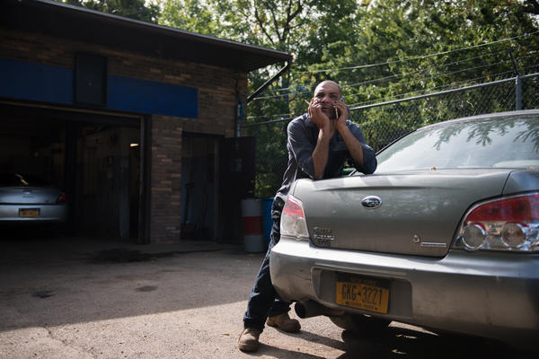 Israel Garcia takes a smoke break while working at Dalbert's Auto Shop. Garcia is extremely weary of this year's election, and he doesn't believe that either presidential candidate will fix the immigration issues in this country.