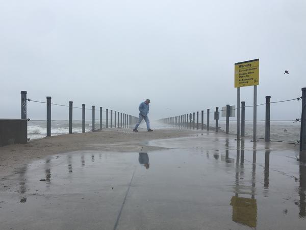 Battling wind and rain on Rochester shoreline
