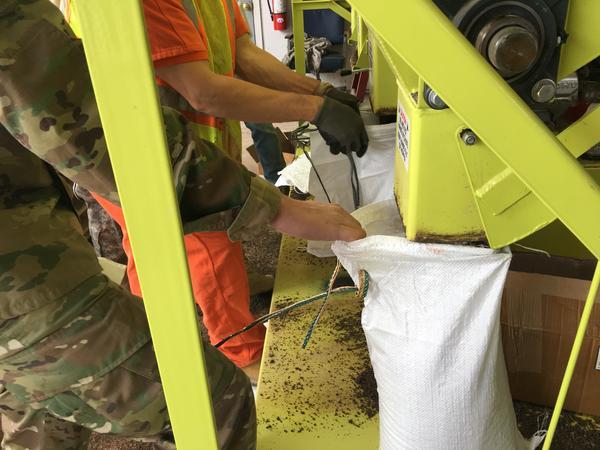 National Guard and jail inmates fill sandbags at Sodus Point, N.Y.