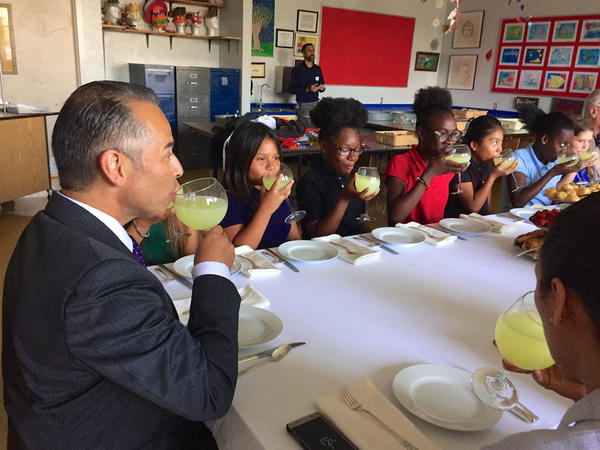 Guatemalan consul Mario René Azmitia toasts fifth graders at high tea at South Grade Elementary in Lake Worth. May 22, 2017.