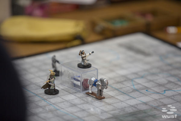 Sometimes Dungeons & Dragons games use miniature figures to represent players' characters.