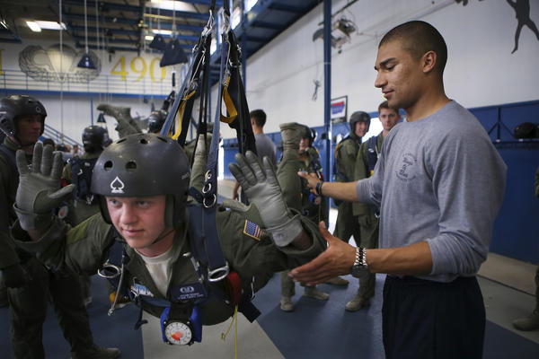 "Alex Williams (right) trains younger cadets to sky-dive. Williams started at the Air Force Academy at what he calls ""the young but old age of 20"" after serving in an Air Force honor guard for two years."