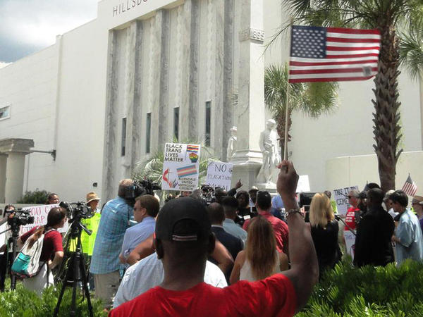 Protesters at the statue in July.