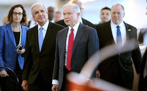 U.S. Attorney General Jeff Sessions (center) arriving at PortMiami Wednesday with Miami-Dade County Mayor Carlos Gimenez (left).