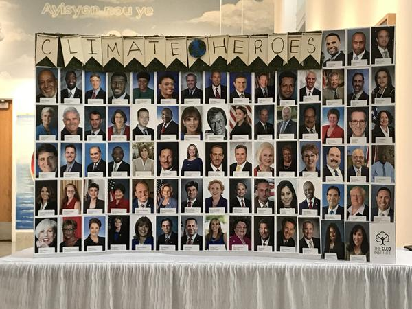 """A display at the """"Climate-Conscious Candidates Celebration"""" featured photos of the more than 70 Florida elected officials being honored."""