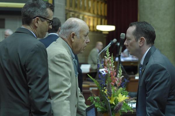 Rep. Warren Love, center, speaks with Rep. Eric Burlison, right, during the 2016 legislative session.
