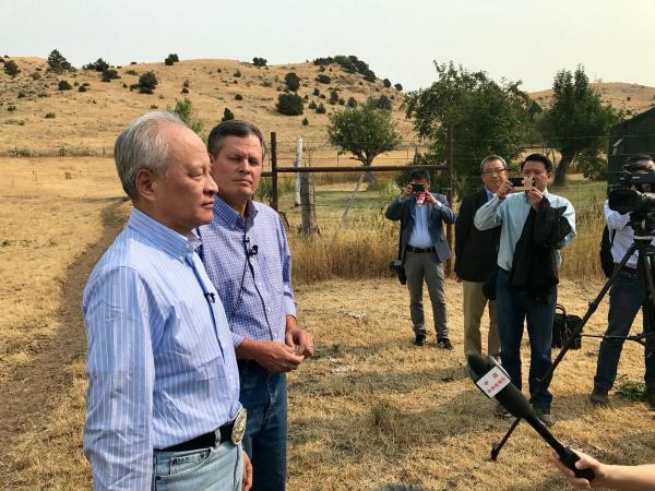 Chinese Ambassador Chui Tian Kai (left) and Republican Senator Steve Daines speak to the press after a meeting at a ranch near Belgrade, Montana.