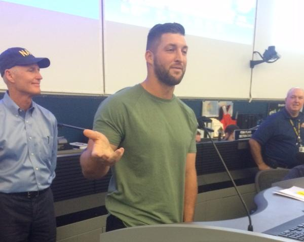 Former University of Florida quarterback and Heisman winner Tim Tebow joined Gov. Rick Scott Tuesday to thank workers at the state Emergency Operations Center in Tallahassee. The two also visited a special needs shelter in Jacksonville Monday night.
