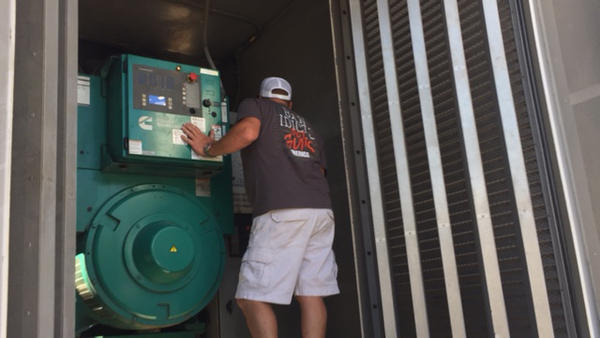 A generator arrives to deliver enough power to run the air conditioners at a nursing home in Deland.