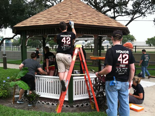 Pat Tillman Scholars paint the garden gazebo at the Haley's Cover Community Living Center.
