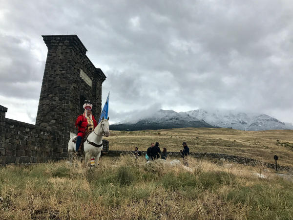 Running Weasel of the Blackfoot Confederacy sits on horseback near the historic Roosevelt Arch near Yellowstone National Park.