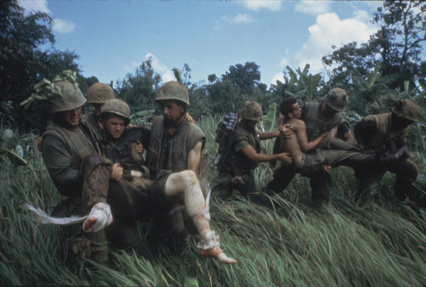 Marines carry men wounded in a 1966 firefight in Vietnam.