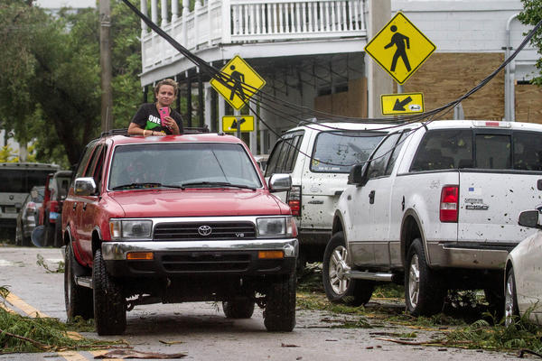 Keys residents make their way through Key West to survey the damage after the storm had passed Sept. 10.