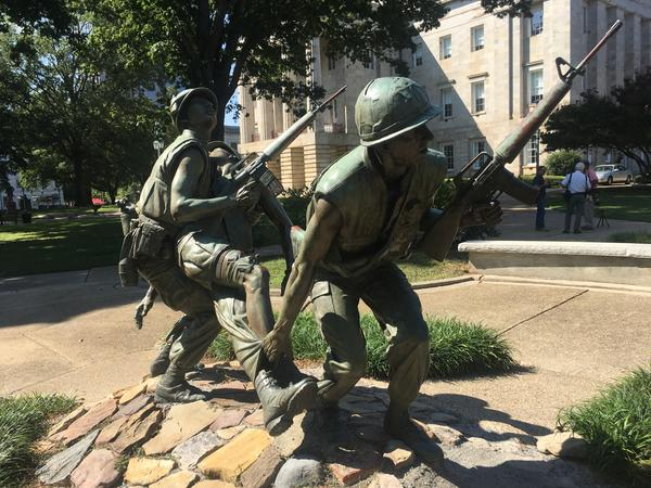 """Entitled """"After the Firefight,"""" this memorial honors the more than 206,000 men and women of the state who served in Vietnam. The monument depicts two soldiers carrying a wounded comrade to a nearby landing zone to await medical help."""