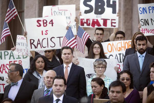 Demonstrators protest against Senate Bill 4 outside the Capitol in April.