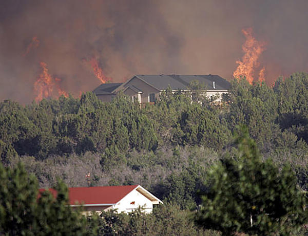 File photo. Some insurance companies are choosing not to renew policies in wildfire-prone areas.
