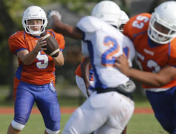 Hollywood Hills quarterback Holly Neher became the first female starting quarterback in Broward County and likely the state of Florida.