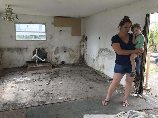 Patty Demere has lived in her Everglades City trailer home for about a decade. Hurricane Irma flooded the trailer and left mold and mud behind. Demere is working with FEMA for help to rebuild. She holds her son Augustus on her hip. He's youngest of five.