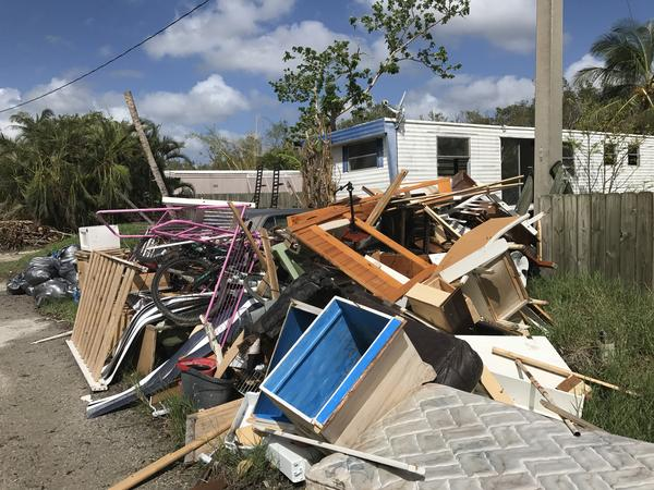Debris waiting for pickup outside of Patty Demere's home.