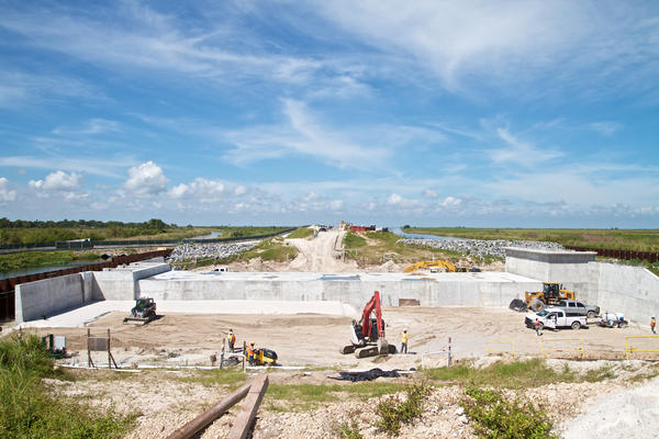 Heavy equipment operators work to reinforce a section of the Herbert Hoover Dike near Clewiston on Oct. 9, 2017. Florida Gov. Rick Scott wants the federal government to fast track completion of the project.