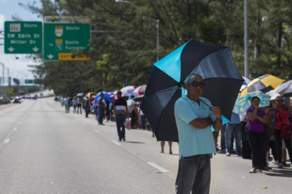 Ramon Heredia, 60, from Hialeah, stands in line in hopes of receiving aid from a post-hurricane disaster center in Tropical Park in Miami on Sunday, Oct. 15.