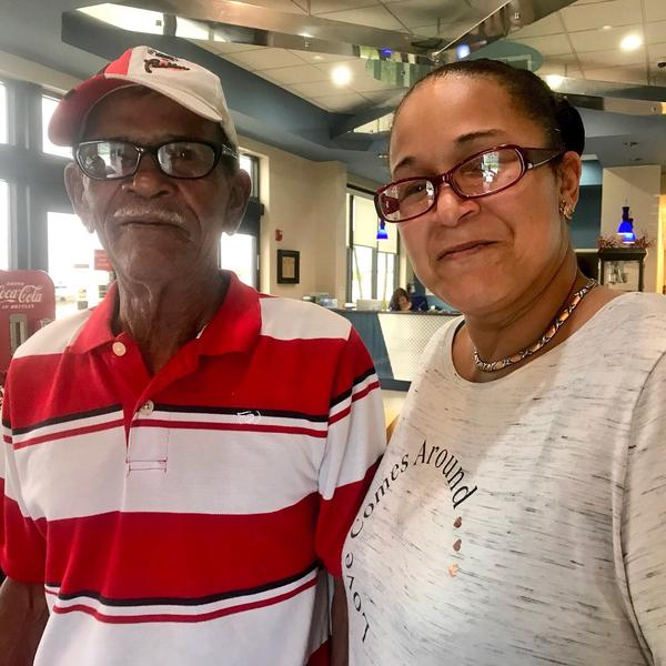 Carla Osorio picked up her father, Juan Gimenez, at the Sano Jet Center Saturday. Together, they'll drive to Orlando to see Gimenez's wife in the ICU at Florida Hospital.
