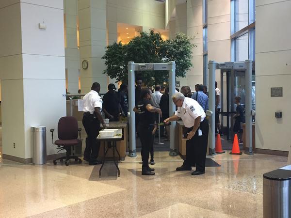 Protestors walk through Government Center security.