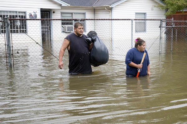 Two days earlier, Christy and Raul Garcia evacuate from their East Houston home as Hurricane Harvey brought record floods to the Houston Area.
