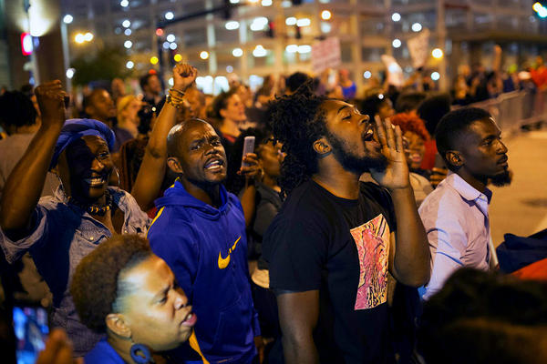 Protesters chant outside Busch Stadium during a Cardinals game on Sept. 29.