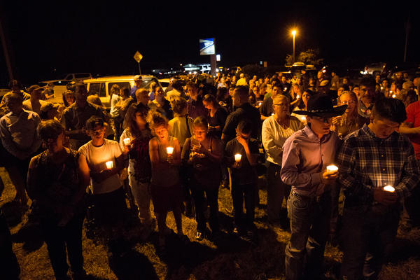 Dozens held a candlelight vigil Sunday night for the 26 people killed in a shooting at the First Baptist Church in Sutherland Springs.