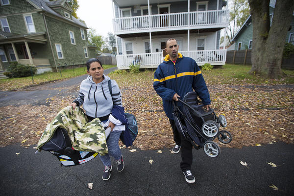 Alicea and Santini walk outside their apartment in Greenfield on their way to Enlace. (Jesse Costa/WBUR)