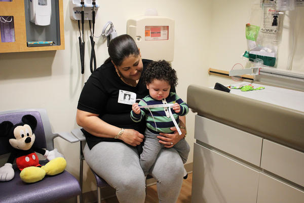 Yaritza Martinez holds her son, Yariel, during a visit to Children's National Health System in Washington D.C. She was infected with the Zika virus while pregnant, but Yariel seems to be doing fine.