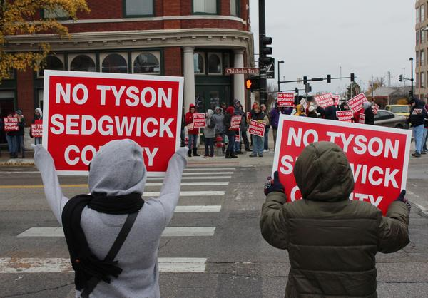 Protesters gather at the intersection of Douglas and Emporia to demonstrate against a proposed Tyson facility in Sedgwick County.