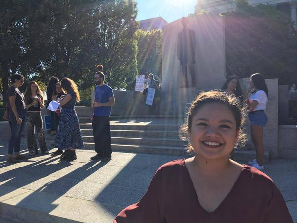 Lisset stands outside the capitol after a rally on Sunday