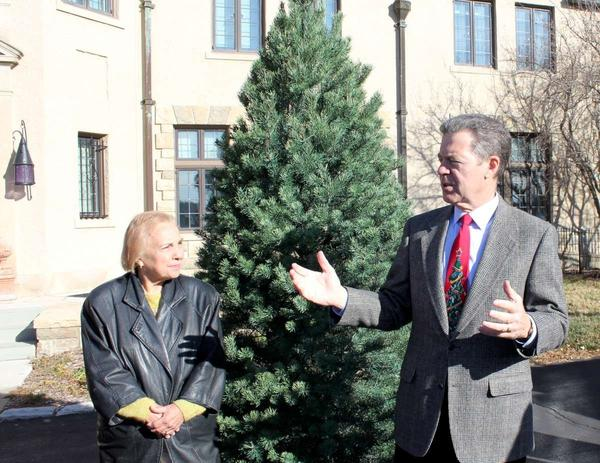Celia Goering and Gov. Sam Brownback with the official Christmas tree for the governor's mansion.