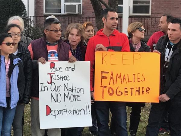 Supporters of Miriam Martinez hold a rally outside her home in Stamford on Tuesday. Martinez had been ordered by Immigration and Customs Enforcement to leave the country by Monday, but chose to seek refuge at her home with her husband and daughters.