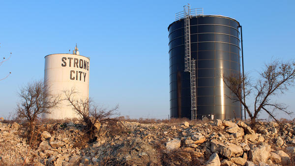 A new water tank in Strong City, Kan., (at right) sits next to one that was part of an old leaky system on a hill just outside the city limits.