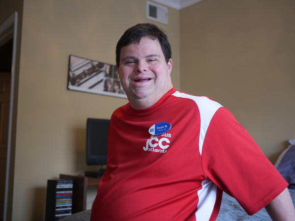 Evan Nodvin, seen here in his Atlanta-area apartment, uses services that are covered by Medicaid.