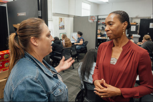 Clinical psychologist Miatta Snetter (right) speaks to Marine Corps veteran Sherry Pope at the Fullerton College Veterans Resource Center.  Snetter says woman sometimes feel uncomfortable around male veterans at the VA.