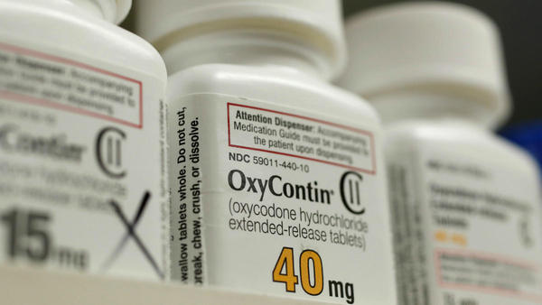 Bottles of the prescription painkiller OxyContin (40 mg pills) made by Purdue Pharma L.D. sit on a shelf at a local pharmacy.