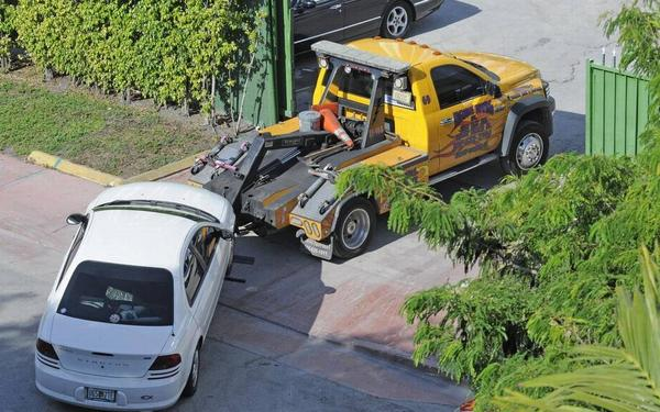 A wrecker tows into Tremont Towing company 1916 Bay Road, Miami Beach, in 2011.